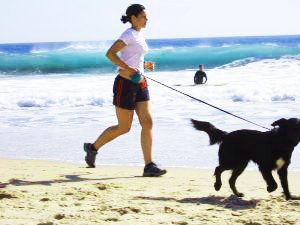 Women running with a dog
