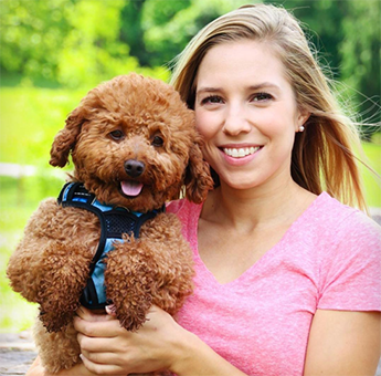 Blond Girl Holding Support Dog